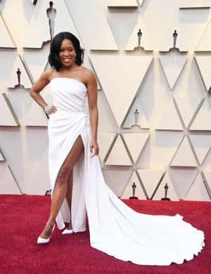 """Regina King, who won the award for Best Supporting Actress for her role in In Beale Street Could Talk, wore a white Oscar de la Renta dress with thigh-high split. """"[We wanted] to create something timeless yet modern… with an air of coolness… and also a jolly spirit,"""" one half of her styling duo, Wayman Bannerman, told Vogue."""