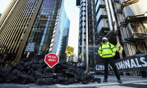 Insurance Rebellion activists protest outside the Lloyd's building in London