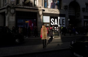 A woman heads to Topshop