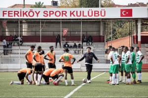 The teams before the beginning of a friendly match at Feriköy Stadium