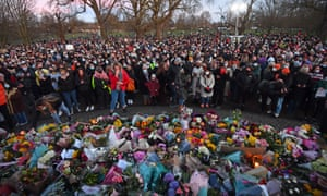 People gather at the bandstand on Clapham Common.