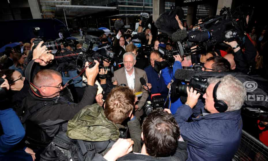Jeremy Corbyn is surrounded by press as he attends Labour's national executive Ccommittee meeting