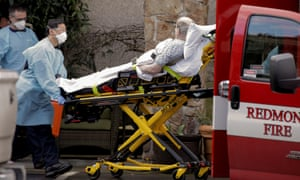 Medics transport a man into an ambulance at a longterm care facility linked to several confirmed coronavirus cases, in Kirkland, Washington Tuesday.