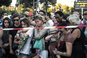 People gather at a makeshift memorial to honour the victims of the attack in Nice