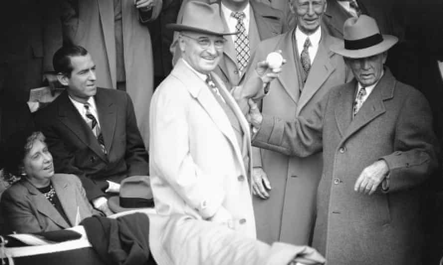 Harry Truman throws out the first pitch at baseball game in Washington, 1949.