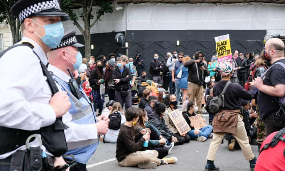 Black Lives Matter protesters stop traffic in Notting Hill Gate in August 2020.