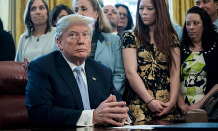 US president Donald Trump signs a new law to punish online sex trafficking at the White House on 11 April.