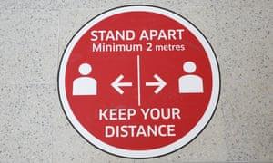 A physical distancing sign at Edinburgh airport