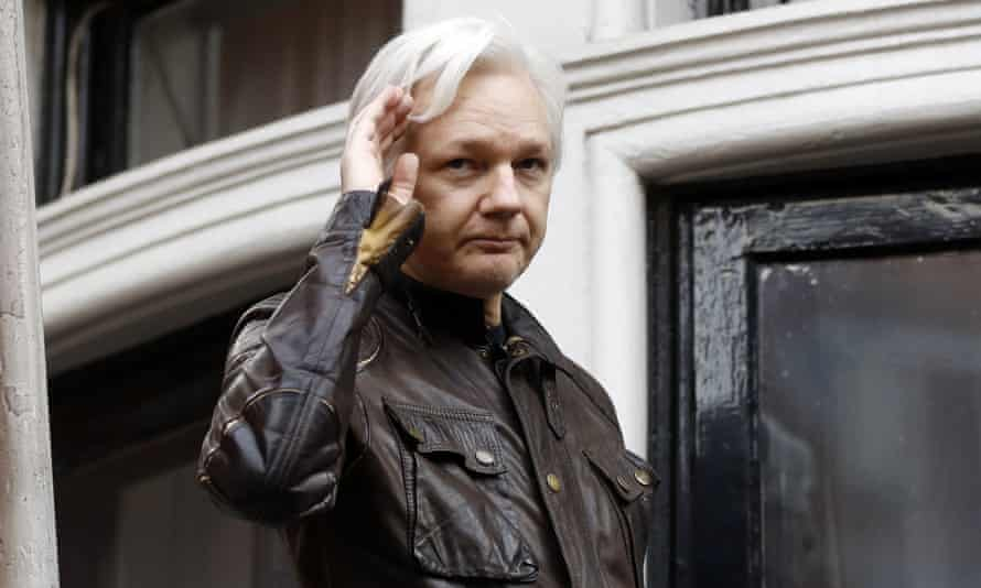 Julian Assange greets supporters from a balcony of he Ecuadorian embassy in London on 19 May 2017.