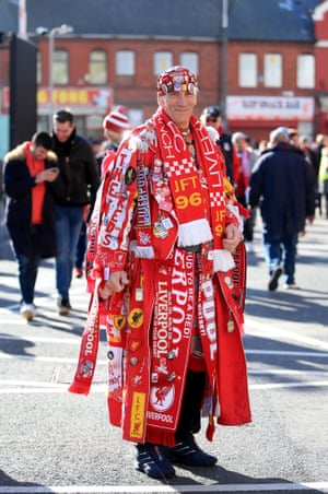 A fan wearing every piece of Liverpool memorabilia he has arrives at Anfield before his team play Cardiff City.