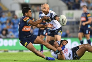 Brian Kelly of the Titans passes during the Round 12 NRL match between the Gold Coast Titans and the North Queensland Cowboys at CBus Super Stadium on the Gold Coast.