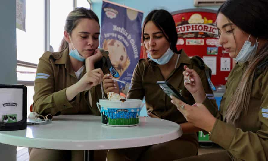 Israeli soldiers eat at the Ben & Jerry's factory in Be'er Tuvia on Wednesday.