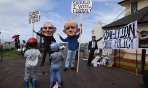 Protesters dressed as former Prime Minister's Tony Abbott and Malcolm Turnbull are seen outside the venue where candidates for the seat of Wentworth were attending a community forum. (AAP Image/Dean Lewins)