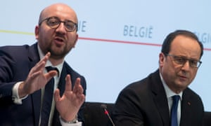 Belgian Prime Minister Charles Michel, left, and the French President Francois Hollande at the press conference in Brussels. After the armed police raid in the Molenbeek district of the city.