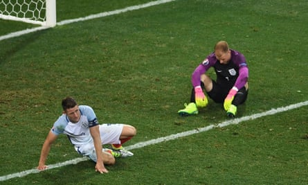 Gary Cahill and Joe Hart react to England's defeat against Iceland at Euro 2016.
