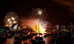 Fireworks explode over the Sydney Harbour Bridge and Opera House during the 9pm display.