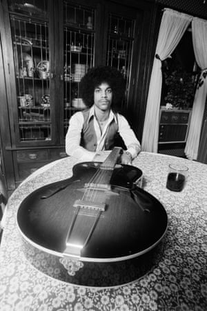 'We're at Prince's manager house here. There were so many instruments there and we were shooting around the house. It was small and full of furniture, but perfect to make Prince feel comfortable. The glass of wine was mine, not Prince's; I don't think I ever saw him drinking during those days. I had a new very wide angle lens and was looking to use it'
