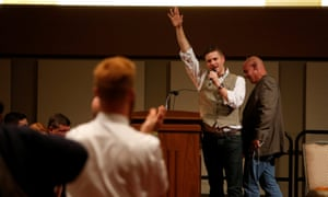 White nationalist leader Richard Spencer of the National Policy Institute waves goodbye after his speech.