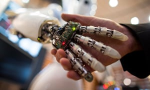 A visitor holds a hand of AILA, or Artificial Intelligence Lightweight Android, during a demonstration at the German Research Center for Artificial Intelligence GmbH (Deutsches Forschungszentrum fuer Kuenstliche Intelligenz GmbH) stand at the 2013 CeBIT technology trade fair on March 5, 2013 in Hanover, Germany. CeBIT will be open March 5-9.   AFP PHOTO / CARSTEN KOALLCARSTEN KOALL/AFP/Getty Images