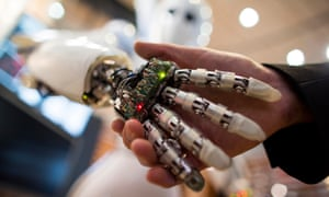 Human holding hands with an android