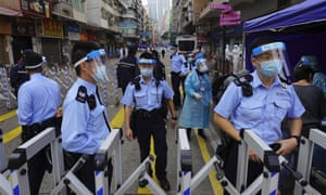 Police officers stand guard at the Yau Ma Tei area in Hong Kong