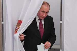 In poll position? Vladimir Putin exits the voting booth after casting his own vote in Moscow