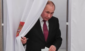 Russian president Vladimir Putin emerging from a polling booth.