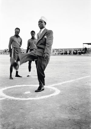 Ghana's first prime minister, Kwame Nkrumah, in his prison graduate cap, kicks a football before the start of an international match at Owusu Memorial Park in Fadama, Accra, in 1952