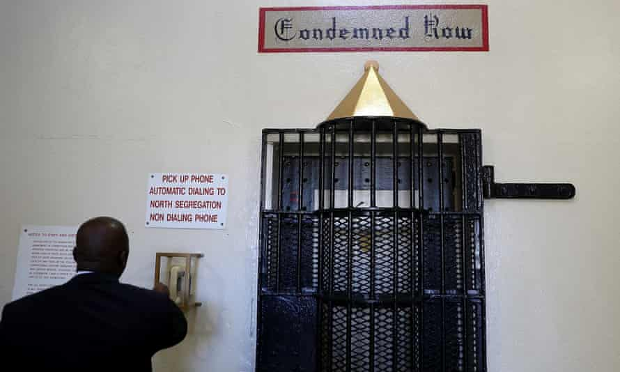 A corrections officer calls to open a door at San Quentin state prison's death row.