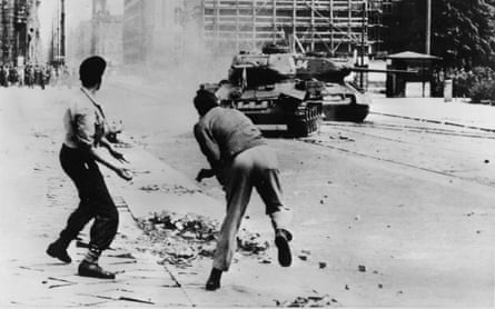 Germans hurl stones against Soviet tanks during pro-democracy protests in June 1953. The demonstrations were brutally suppressed.
