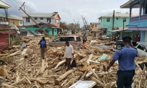 Residents of Roseau, Dominica, survey the damage caused by Hurricane Maria.