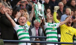 Celtic's Scott Brown and Mikael Lustig celebrate with the trophy after winning the Scottish Cup