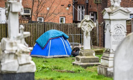 Tent of a homeless person, pitched in a church graveyard, Southend, Essex.