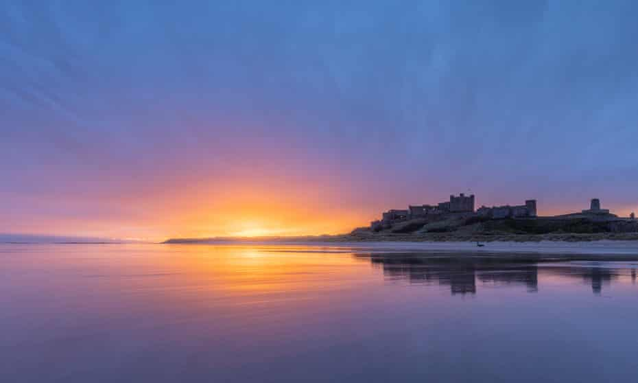 First light over Bamburgh Castle in Northumbria