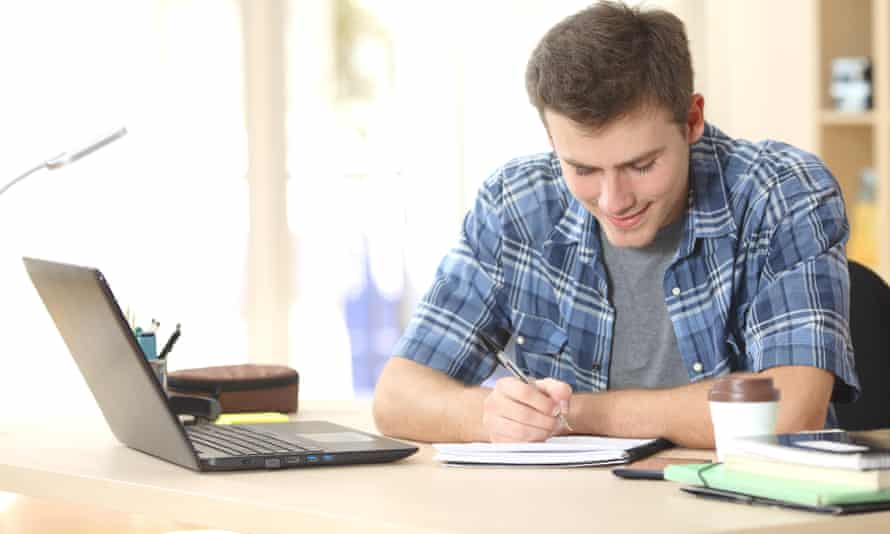 Student studying at a desk at home