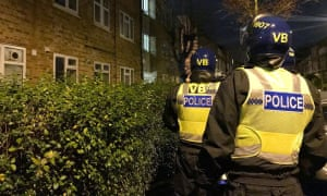 Police prepare to carry out a dawn raid