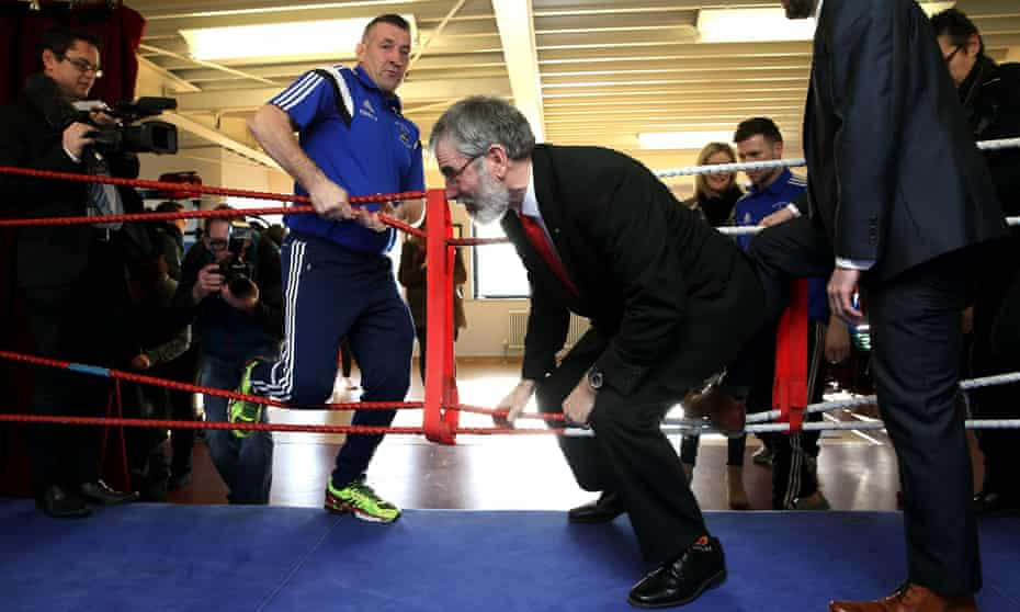 Sinn Fein leader Gerry Adams enters a boxing ring during a visit to Dublin's Mounttown Community Facility in Dun Laoghaire, on Thursday.