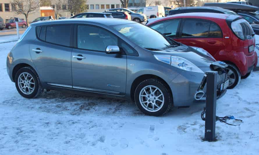 Electric cars charging in snow in Norway