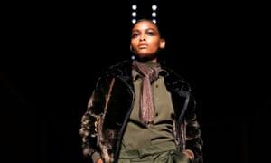 Model in silk shirt on catwalk