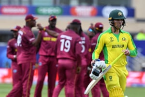 Alex Carey walks after loosing his wicket to Andre Russell for 45.