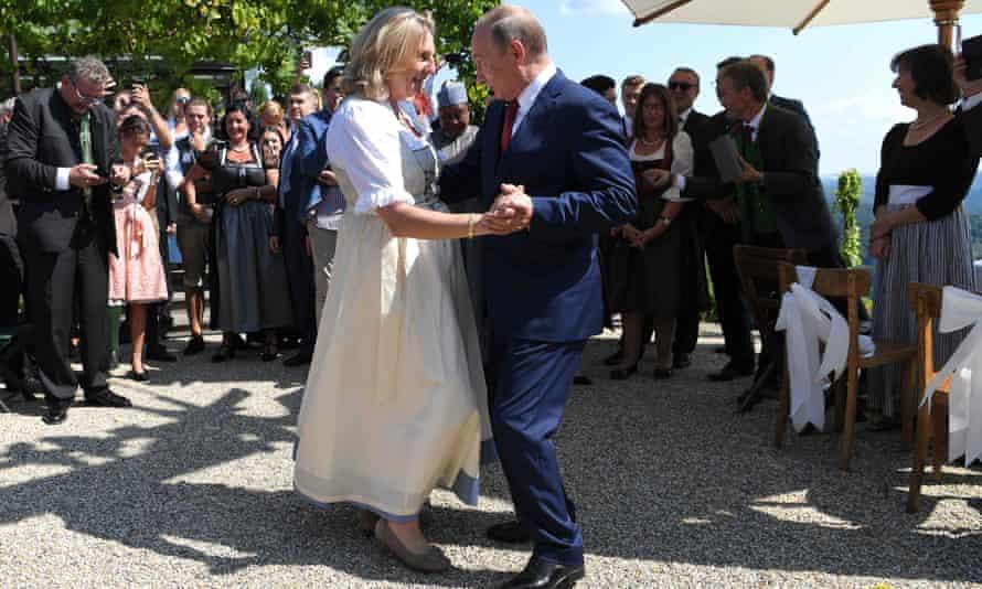 Karin Kneissl and Russian President Vladimir Putin dance at her wedding celebrations.