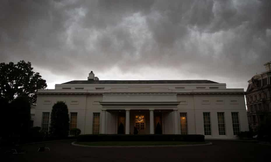 Storm clouds roll in, above the Oval Office.