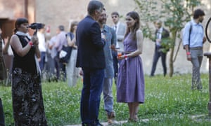Amanda Knox, right, and her boyfriend, centre, talk with a guest at the opening of a conference on wrongful convictions in Modena