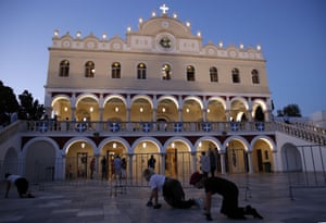 Pilgrims crawl in front of the Holy Church of Panagia of Tinos, on the Aegean island of Tinos, Greece, on Friday, 14 August, 2020. For nearly 200 years, Greek Orthodox faithful have flocked to Tinos for the 15 August feast day of the Assumption of the Virgin Mary, the most revered religious holiday in the Orthodox calendar after Easter. But this year there was no procession.