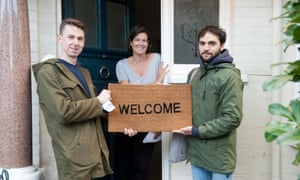 Tim Jonze, left, and Alex Urso knocking on doors in Hammersmith for the Welcome Project.