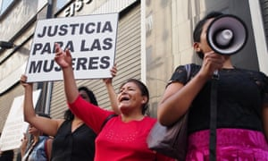Women protest outside the prosecutor's office in Lima demanding justice for rural women who were forcibly sterilised, 10 May 2016.