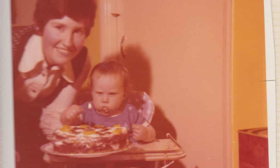 Matt as a toddler in a high chair eating, with his mother