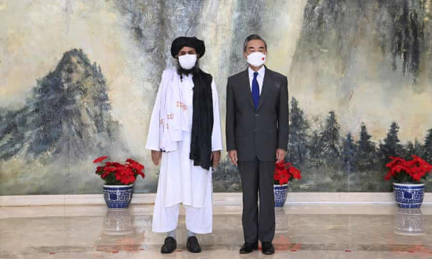The Taliban co-founder Mullah Abdul Ghani Baradar (left) and Chinese foreign minister, Wang Yi, during a meeting in Tianjin, China, in July 2021.