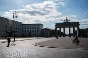 A few socially distanced people on the square Pariser Platz in front of the Brandenburg Gate in Berlin, Germany, on Thursday