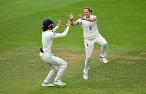 Laura Marsh of England celebrates taking the wicket of Alyssa Healy of Australia.